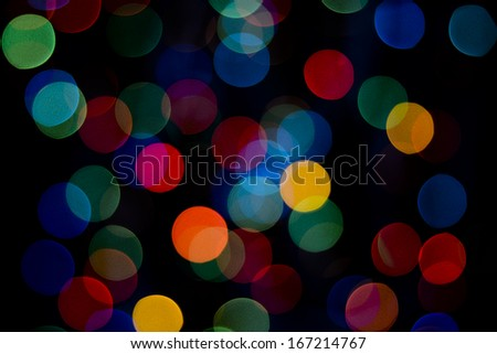 defocused colored lights on the black background