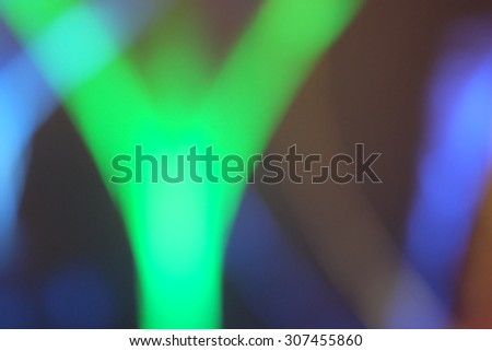 Defocused  colorful lights blurred background, green dominant color - stock photo