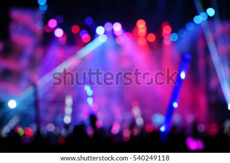 Defocused entertainment concert lighting on stage, blurred disco party.