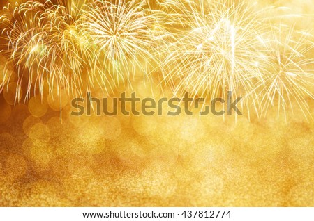 Defocused Gold fireworks and bokeh at New Year and copy space. Abstract background holiday. - stock photo