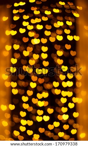 defocused golden lights in the shape of hearts - stock photo
