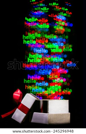 Defocused hello word  lights are moving out of open gift box - stock photo
