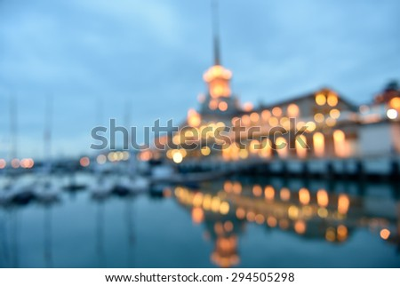 Defocused image of the night view to the seaport of Sochi, Russia - stock photo