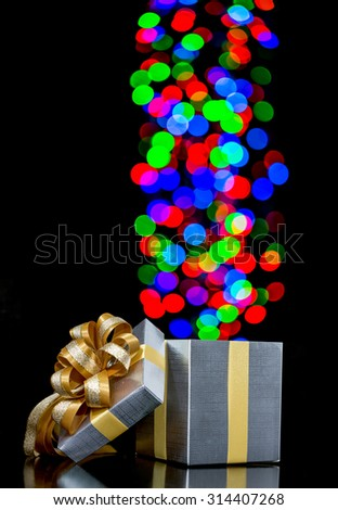 Defocused lights are moving to open gift box - stock photo