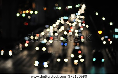 Defocused Lights of Gridlocked Traffic on a Busy City Road at Night