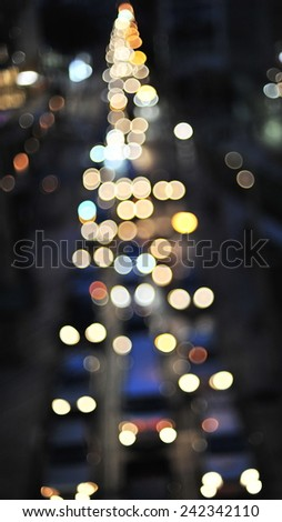 Defocused Lights of Heavy Traffic on a Busy City Road at Night  - stock photo