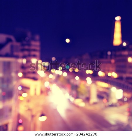 Defocused lights of night Paris. - stock photo