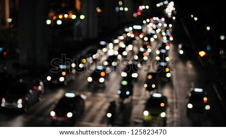 Defocused Lights of Nighttime Traffic on a City Road - stock photo