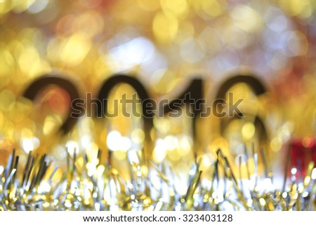 Defocused of Golden 2016 3d icon in the christmas ornaments golden tinsel defocused blur backgrounds - stock photo