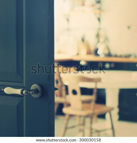 Defocused of Home Kitchen behind Black Door. Toned Effect - stock photo
