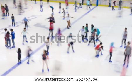 Defocused of indoor ice skating park with skating people. - stock photo