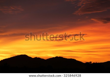 Defocused of sunset over the mountain sky background.