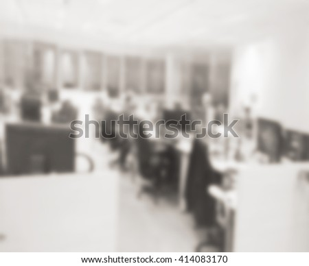 Defocused office space background in vintage monochrome colors. Blurred office with people silhouettes. Working space with computer screens. Hi-tech office background. Blurred office room. - stock photo
