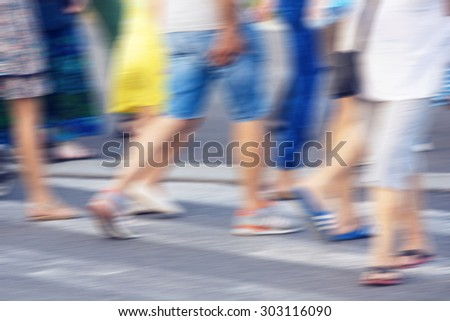Defocused people crossing zebra, blurred and color graded, with instagram effect - stock photo