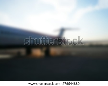 defocused photo of airplane at sunset - stock photo