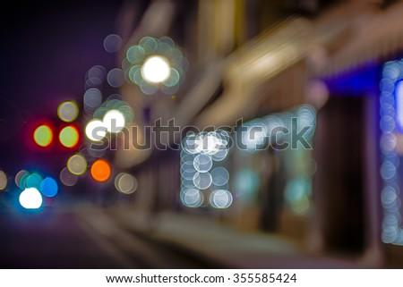 defocused storefront sidewalk lights at night - stock photo