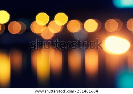 defocused street lamps and reflection on a water, natural photo image - stock photo
