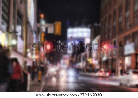 Defocused street scene at night - stock photo