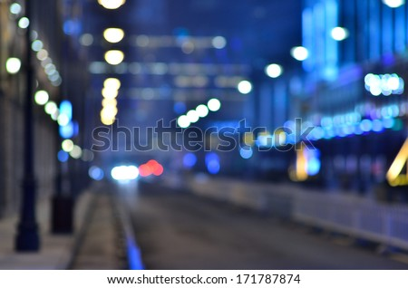 Defocused urban abstract texture background -- light bokeh   - stock photo