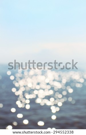 Defocused view at sea or ocean on relaxed quiet day - stock photo