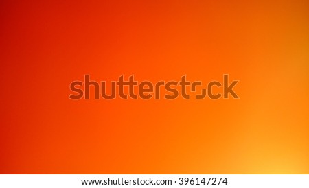 Defocused warm red and orange summer colors background - stock photo