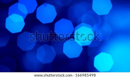 Defocussed Christmas light - blue - stock photo