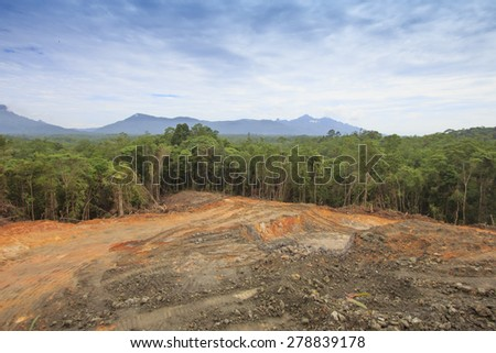 Deforestation: Scarred earth where tropical rain forest has been destroyed by human development in Borneo, Malaysia - stock photo