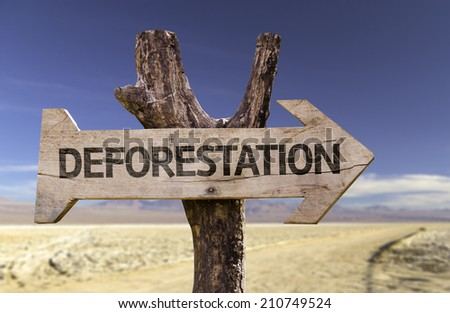 Deforestation wooden sign with a desert background  - stock photo