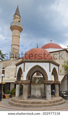 Deftendar Mosque at Freedom square of Kos island in Greece - stock photo