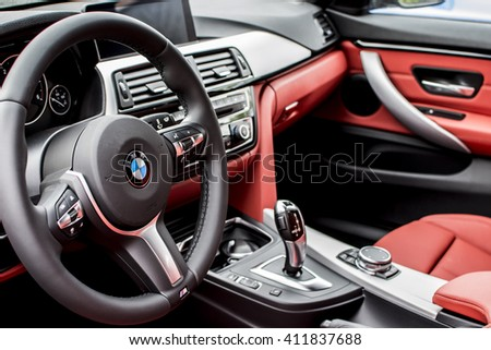 Deggendorf, Germany - 23. APRIL 2016: red leather interior of a 2016 BMW 4 Gran Coupe during the luxury cars presentation in Deggendorf.  - stock photo