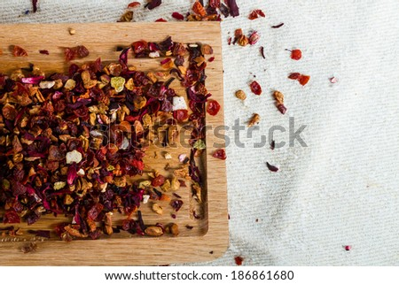 Deicious caffeine-free infusion of dried fruit, acai and goji berries. - stock photo