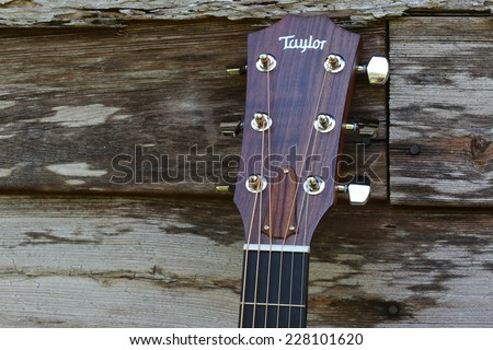 DeLand, FL, USA - November 3, 2014: Taylor Guitar celebrates its 40th year anniversary this year.  The El Cajon, California company is now the No. 1 manufacturer of acoustic guitars in the USA. - stock photo