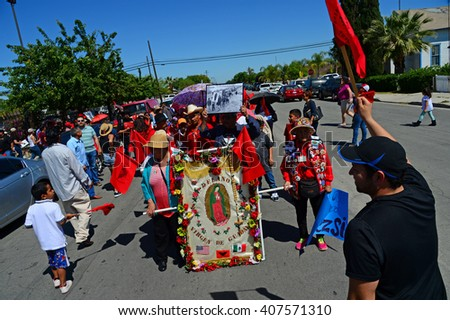DELANO, CA - APRIL 17, 2016: The members of the United Farm Workers are marching today in support of immigration reform , overtime pay for agricultural workers and to honor Cesar Chavez's birthday.