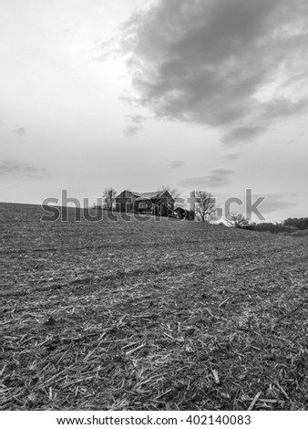 Delapidated old barn on hill in cornfield in rural PA