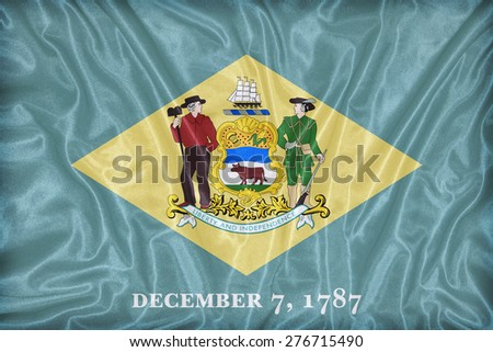 Delaware flag pattern on fabric texture,retro vintage style - stock photo