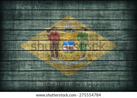 Delaware flag pattern on wooden board texture ,retro vintage style - stock photo