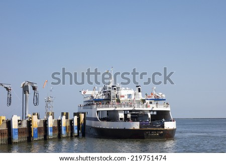 DELAWARE, UNITED STATES - SEPTEMBER 4, 2014:  The Cape Henlopen, one of the Cape May-Lewes Ferry fleet pulls into dock after returning from Cape May, New Jersey. - stock photo