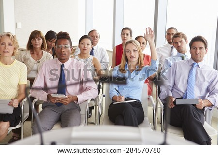 Delegate Asking Question At Business Conference - stock photo