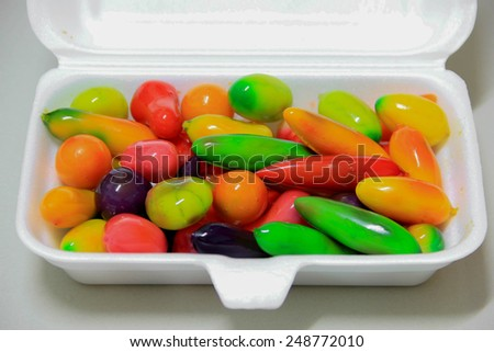 Deletable imitation fruits-Traditional Thai Dessert made from nut and jelly in foam carton. - stock photo