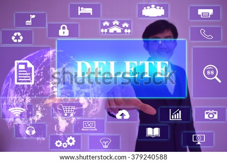 DELETE concept  presented by  businessman touching on  virtual  screen ,image element furnished by NASA - stock photo