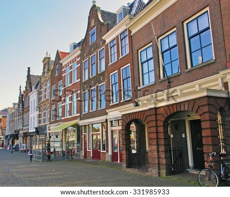 DELFT, NETHERLANDS - MARCH 25, 2012: View of the street in city centre of Delft on March 25, 2012. Delft is a city in the province of South Holland, Netherlands.