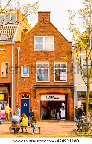 DELFT, NETHERLANDS - MAY 2, 2015: House in the center of Delft, Netherlands. Delft is a popular touristic destination due to the town centre with canals