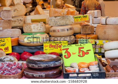 DELFT,NETHERLANDS - SEPTEMBER 27: Show-window with cheese in shop, Delft, Holland, September 27,2012. The volume of export of Dutch cheese makes 7 billion euro a year