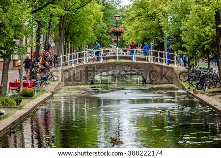 DELFT, THE NETHERLANDS - JUNE 17, 2014: City landscape of old town. Delft - beautifully preserved historic city - from a rural village in the early Middle Ages Delft developed to a city.