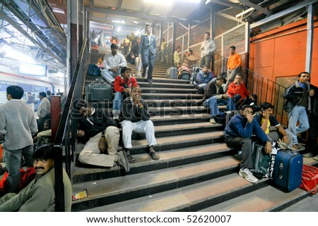DELHI - FEBRUARY 19: Crowded train station platform on February on February 19, 2008 in Delhi, India. Indian railways transport 20 million passengers daily.