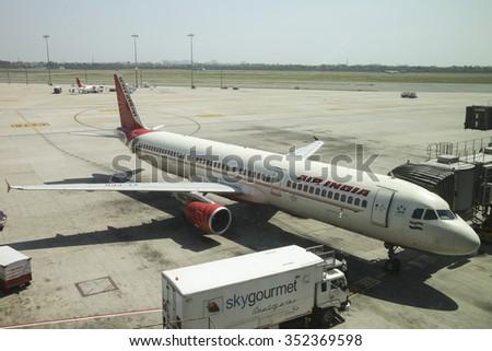 DELHI, INDIA - 25 April, 2015. Air India A321 Airbus aircraft in Delhi Airport as it gets loaded .  - stock photo