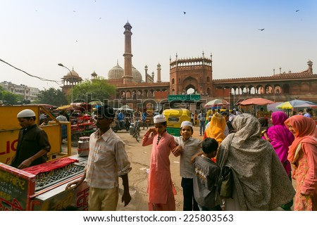 DELHI, INDIA - CIRCA MAY 2014: Overcrowded street in old town, and the Jama Masjid Mosque.The Jama Masjid is the principle mosque of Old Delhi.