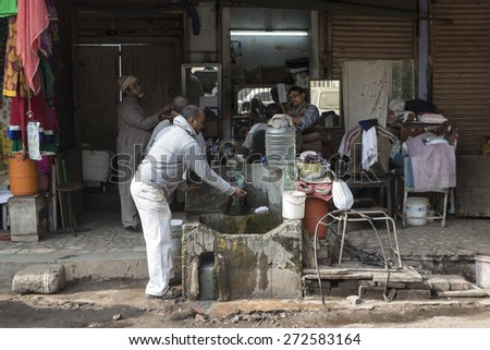 DELHI INDIA - DEC 20 :  barber shop in chandni chowk. this area is in old delhi, that is famous place of delhi on december, 20, 2014, india