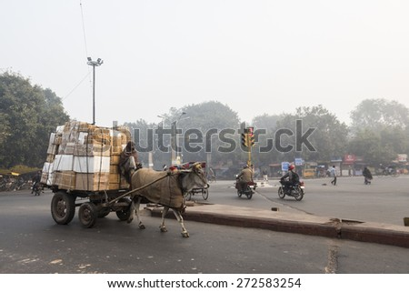 DELHI INDIA - DEC 20 : group of rickshaw driver waiting for passengers near old delhi railway station. this area is in old delhi, old delhi is famous place of Delhi on december, 20, 2014, india - stock photo