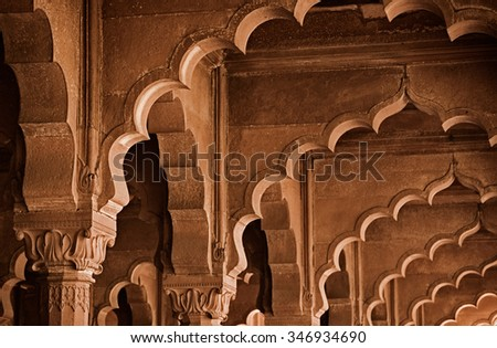 Delhi, INDIA - 01 DEC 2012: Interior parts of the building - the arch. Sandstone is soft and ephemeral stone - stock photo